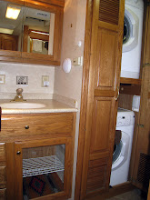 Photo: Washer and dryer next to bathroom sink