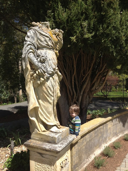 Photo: This young boy doesn't mind that the statue has been decapitated. (Photo by Ross Peart). Week of April 20, 2012.