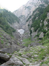 "Photo: Poiana ""La Verdeata"": priveliste frumoasa spre Valea Alba si zapada inca ramasa acolo...  Blog post: http://l.blog.iacob.name/2016/07/poiana-la-verdeata-costilei-caminul-alpin.html"