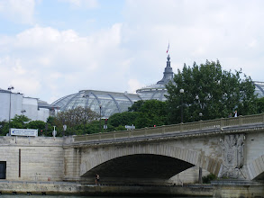 Photo: We pass by the Grand Palais, the glass exhibition hall built for the Paris Exhibition of 1900. The exterior of the massive palace combines an imposing Classical facade with Art Nouveau ironwork.