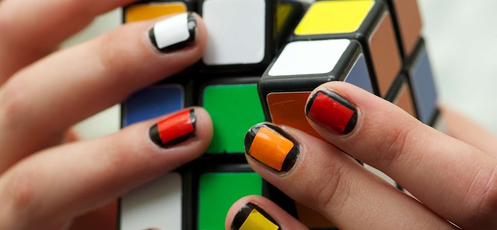 hands with rubik's cube painted