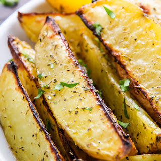 Extra Crispy Baked Garlic & Herb Potato Wedges