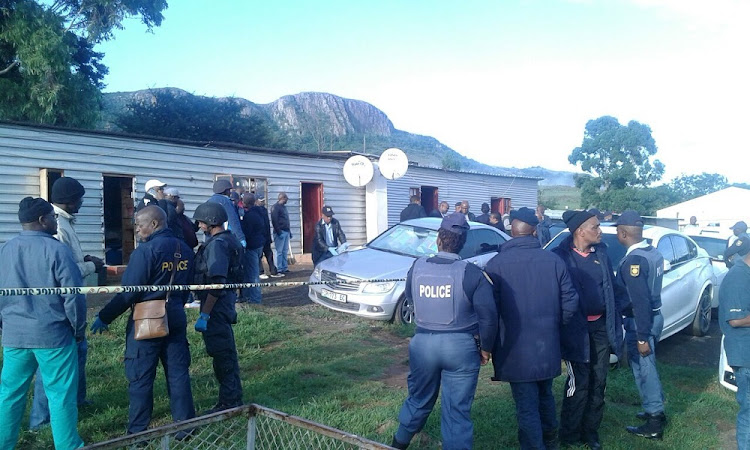 Police outside Mancoba Seven Angels Ministry at Ngcobo in the Eastern Cape.