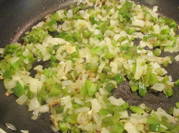 Add the chopped onions and peppers to skillet along with the minced garlic, then...