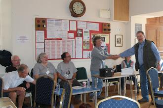 Photo: presentation to Nine Tenths Below