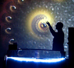 Photo: Draves' silhouette makes contact with the Electric Sheep.
