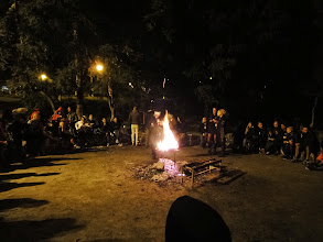 Photo: Introductions and discussion around the fire