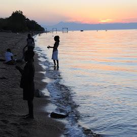Sundown Children by DJ Cockburn - Landscapes Beaches ( niassa, fishermen, nyasa, lake malawi, sunset, cape maclear, africa,  )