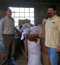 Photo: Brian discusses the processing of alpaca with Alfred or INGA Alpaca.