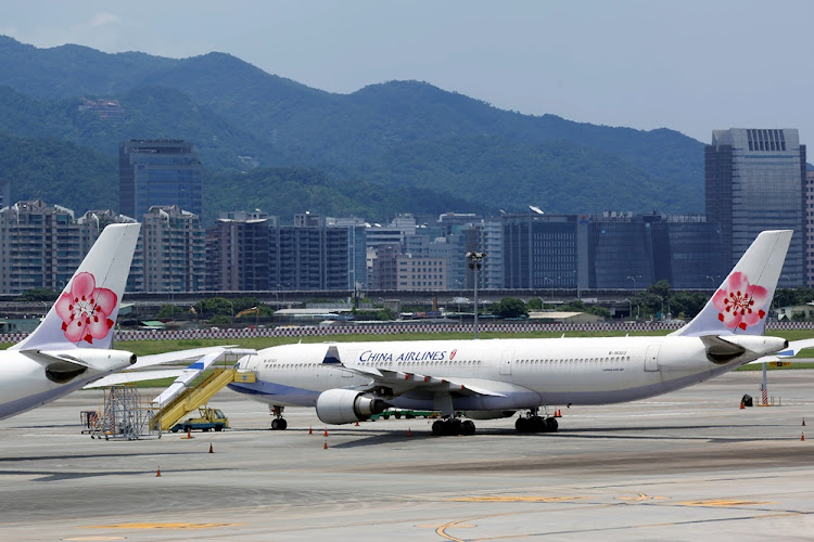 China Airlines aircraft  stand on the tarmac at Songshan Airport in Taipei, Taiwan. Picture: REUTERS