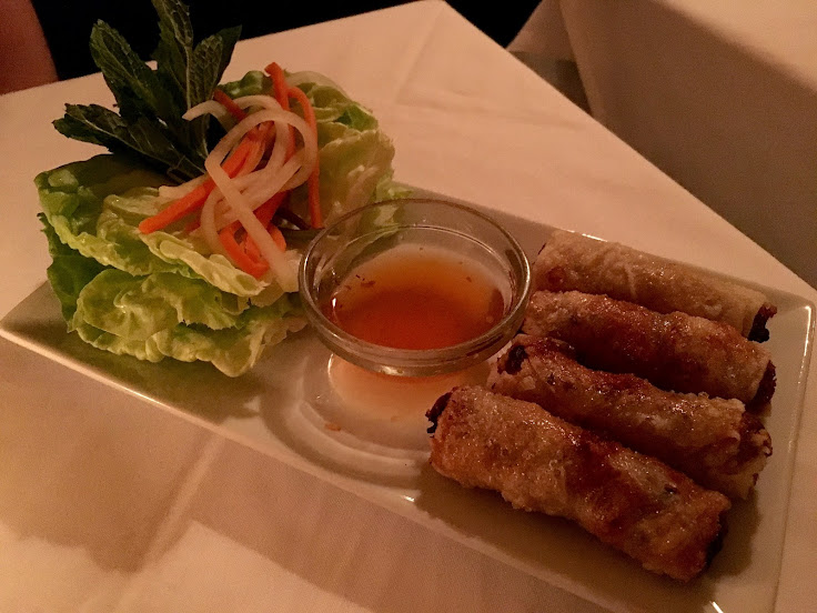Fried spring rolls. Wrap in the lettuce and pickled veggies and eat by hand.