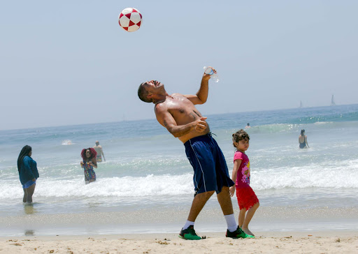 Soccer-on-beach.jpg - A man balances a soccer ball on Venice Beach in the city of Los Angeles.