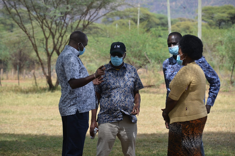 Titay MP William Kamket, Baringo Senator Gideon Moi and Woman Representative Gladwel Cheruiyot during a peace meeting at Lake Bogoria resort on Saturday last week.