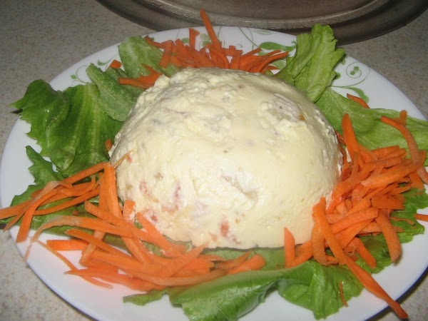 Unmold onto lettuce leaves and trim with carrot sticks.