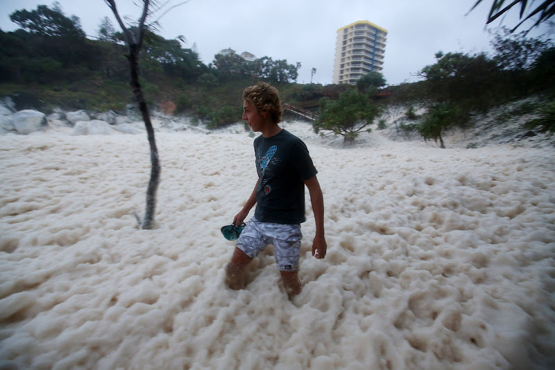 Photo: GOLD COAST, AUSTRALIA - JANUARY 28:  A man walks through ocean foam in Snapper Rocks as Queensland experiences severe rains and flooding from Tropical Cyclone Oswald on January 28, 2013 in Gold Coast, Australia. Hundreds have been evacuated from the towns of Gladstone and Bunderberg while the rest of Queensland braces for more flooding.  (Photo by Chris Hyde/Getty Images)