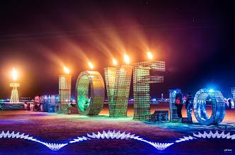 Photo: Love on Fire Amazing art graces the playa at Burning Man 2014. #love #burningman #fire