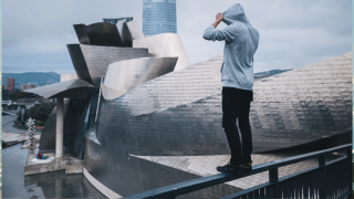 image of man standing on top of building