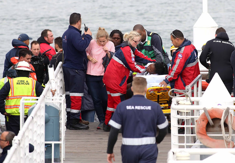 Rescue personnel and passengers from the Thandi after the ferry sank.