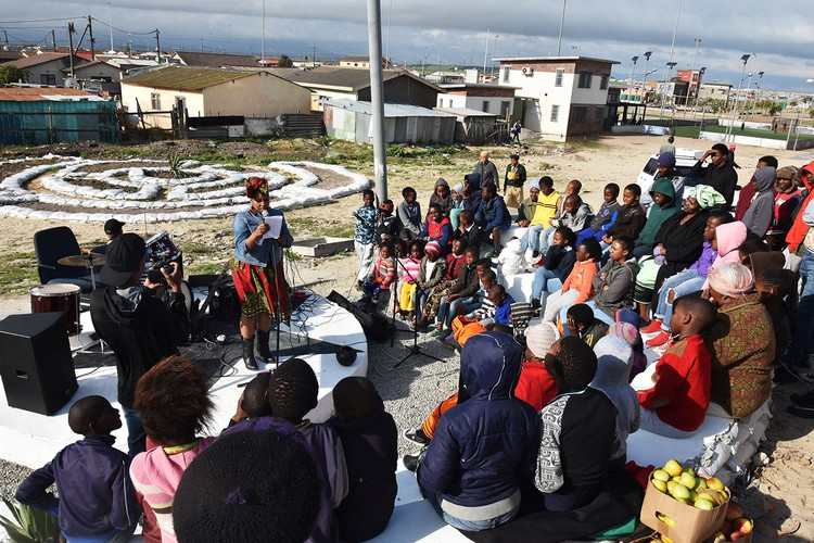 Khayelitsha residents and supporters at the launch of the Ujamaa guerilla gardening project next to the Khayelitsha Football for Hope Centre.