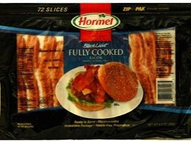 Cook 2 slices of Hormel Microwaveable Bacon as directed and drain grease.  Place on top...