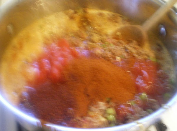 Add chili powders and cumin.  Stir and cook until onion is translucent.