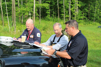Photo: Dave Coffey (PTM) and Tom Gatzunis (TFL) with IMT. Work can happen anywhere the opportunity presents itself.