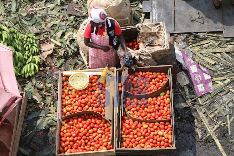 A traderr sells tomatoes along the streets near Gikomba market on July 14, 2020.