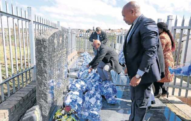 Premier Phumulo Masualle lays a wreath at the Ginsberg Cemetery on Friday, in remembrance of the 28 people who were shot dead by former Ciskei troops