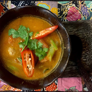 56 Tom Yum Goong (Hot and Sour Thai soup with prawns).