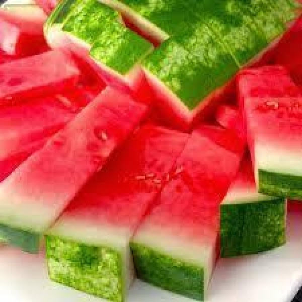 Cut watermelon to your liking place in freezer.  Melt chocolate over double broiler, put aside...