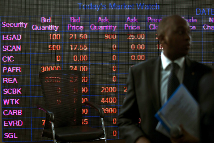 On the board: A man stands in front of an electronic board displaying market data at the Nairobi Securities Exchange in Nairobi, Kenya. Picture: REUTERS