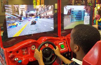 Photo: Q plays racecar games