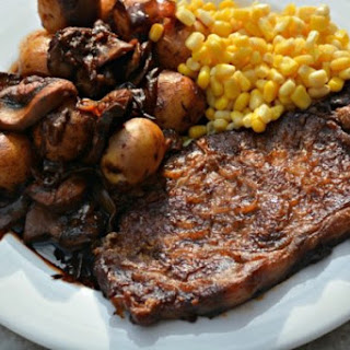 Baked Steak with Potatoes, Mushrooms and Onions.