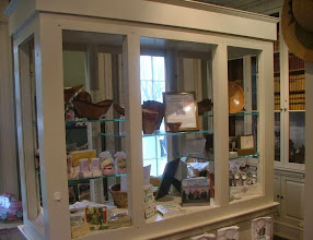 Photo: This display cabinet in the gift shop is set up with some turned wood from the Tudor Place white oak.