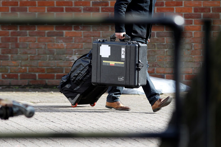 Inspectors from the Organisation for the Prohibition of Chemical Weapons arrive to begin work at the scene of the nerve agent attack on former Russian spy Sergei Skripal, in Salisbury, Britain, on March 21 2018. Picture: REUTERS