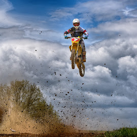 by Marco Bertamé - Sports & Fitness Motorsports ( clouds, speed, jumpflying, number, yellow, race, noise, red, sky, motocross, 7, blue, dust, clumps, air, grey, high )