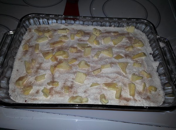 Scatter butter pieces over cake mix.