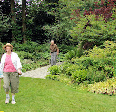 "Photo: Randy and Mary-Carter on their way from the ""entry room"" garden to the perennial borders ""room"""