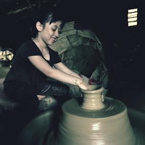 The Potter by Jon Soriano - People Portraits of Women ( child, vigan, ilocos, girl, potter, jonr, pottery, pots, philippines )