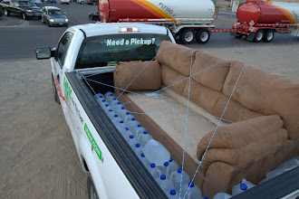 Photo: 2 things you need when in desert - 75 gallons of water and a couch!