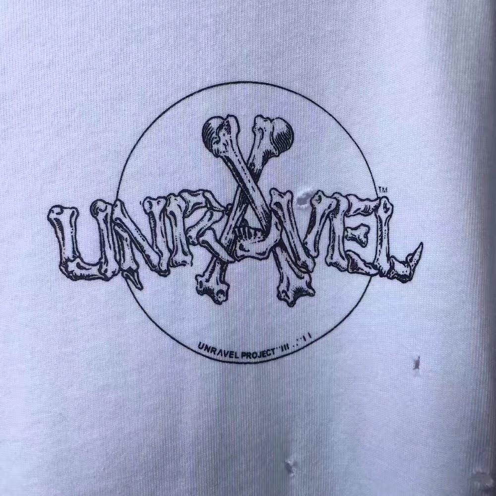 UNRAV TEE