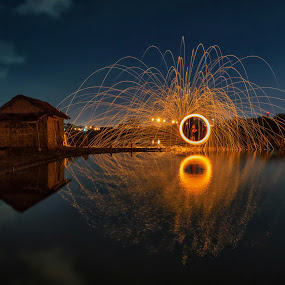 Playing fire in fishpond by Raden Bagus Paijo - Abstract Fire & Fireworks ( steel wool, waterscape, landscape, night shot, nightscape )