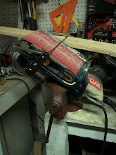 Photo: A side view to show how the belt sander is held by the vice.