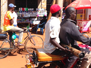 Photo: Kampala (that's a muffler he's holding?)