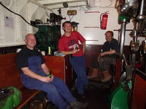Photo: Dennis van S., Dennis B. en Bas B., na een lange werkdag even een biertje doen