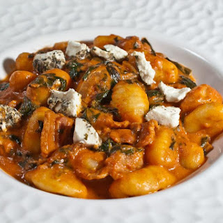 Gnocchi with Bacon, Spinach, Vidalia Onion and Herbed Goat Cheese in Rosé Sauce.