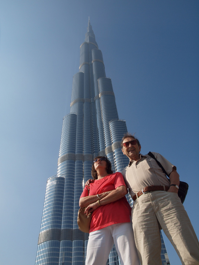 Photo: Backed by the highest building of the world. We are dam' small...but highly spirited.