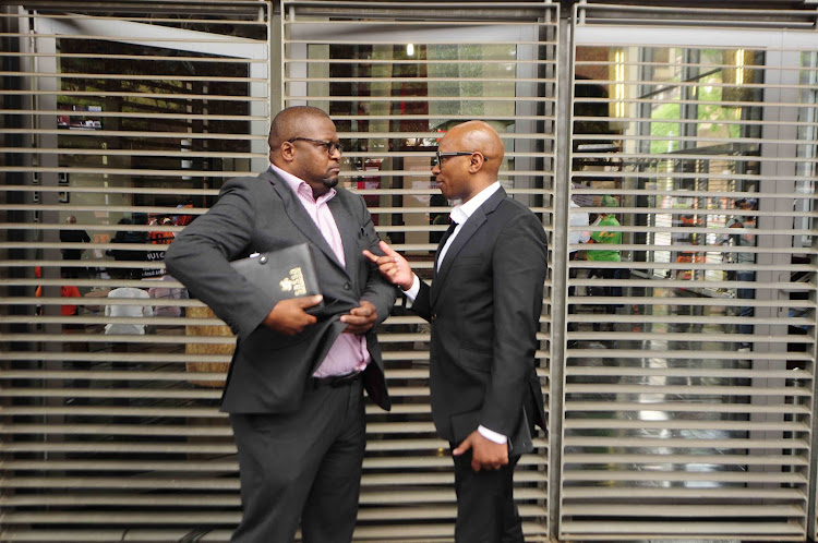 ANC spokesperson Zizi Kodwa and SASSA CEO Thokozani Magwaza outside the Constitutional Court. File photo.