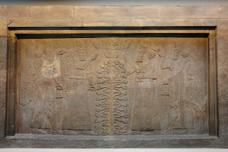 "Photo: Assyrian king Ashurnasirpal from Nimrud with protective ""gods"" working on the the tree of life which looks suspiciously like the DNA double helix. Again all with their standard gear: wings, two wristwatches, utility case. British Museum."