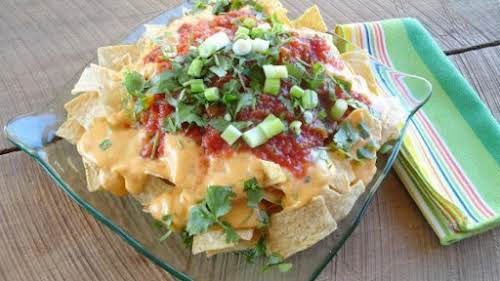 "Ultimate Nachos with Homemade Cheese Sauce ""This nacho cheese sauce recipe is..."